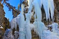 These are amazing ice formations draping from the walls of the Johnston Canyon at the Upper Falls location during the winter in the Canadian Rocky Mountains. Johnston Canyon is located in Alberta in Banff National Park.