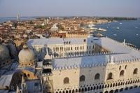 The Ducal Palace, the domes of Saint Marks Basilica and a panoramic view of Saint Marks Basin in Venice, Italy.