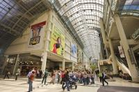 The interior of Eaton Centre in the downtown area of Toronto, Ontario in Canada where people spend many hours shopping.