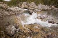 The Elbow River and falls are a year round attraction in Alberta, Canada