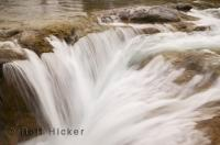 Creating a veil like waterfall, the Elbow River in the Kananaskis Country, Alberta, plunges over a 6 metre drop before continuing on it way.