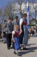 A European child looking pretty in her traditional dirndl at the Maibaumfest in Putzbrunn, Germany.