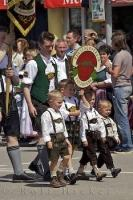 The children at a European festival walking with a local sign in Putzbrunn, Southern Bavaria, Germany.