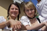 These girls enjoy the traditional German European Maibaumfest celebrations in the small village of Putzbrunn, near Munich, Germany.
