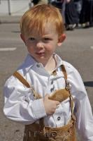 A European boy dressed in traditional lederhose ready for the party at the Maibaumfest in Putzbrunn, Germany.