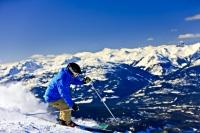A daring experienced alpine skier navigates the upper slopes of Whistler Mountain in British Columbia. People from all over the world come to Whistler for the first-class skiing and now it is set to co-host the 2010 Winter Olympic Games.