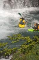 A hard hat, and helmet are just some of the safety equipment needed for extreme kayaking.