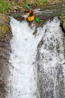One of the kayaking extreme sports is running over a waterfall, this kayaker is just going over the edge, Catalonia, Spain.