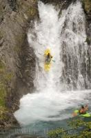 Waterfall running the extreme watersport of paddling over a waterfall in a kayak.