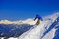 The majestic snowy mountain peaks are a challenge for skiers as they enjoy the dare of extreme winter skiing on the higher slopes of Whistler Mountain in beautiful British Columbia, Canada.
