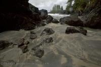 Water flows through a passage into the wide open ocean in San Josef Bay on Northern Vancouver Island in BC, Canada.