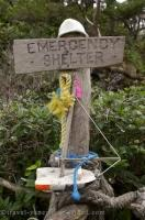A sign along the Cape Scott Trail on Northern Vancouver Island directs you to a shelter in case of an unforeseen emergency.