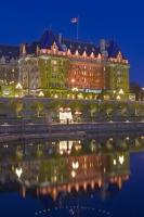 A historic hotel situated in a prime location, the Fairmont Empress, overlooks the inner harbour in the city of Victoria.