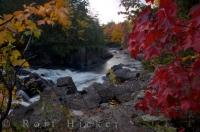 The shades of Fall decorate the scenery alongside the waterfall, continuing down the river banks and throughout Mont Tremblant Provincial Park in Quebec, Canada.