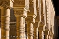 Finely detailed columns within the Chamber of the Lions at Alhambra Palace are among the most famous pieces of architecture in the city of Granada, Andalusia, Spain.