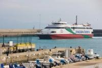 The fast ferry arriving in the harbour in the town of Tarifa in the Province of Cadiz in Andalusia, Spain in Europe.