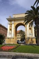 The impressive Finale Ligure Arch in the Piazza Vittorio Emanuele II along the waterfront in the town of Finale Ligure, Liguria in Italy, Europe.