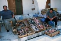 Men selling fish on a fish market in Fira, Santorini
