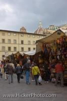 Visitors to the City of Florence in Tuscany, Italy spend many hours shopping at the market stalls where they can find a wide selection of goods.