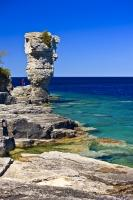 This picture illustrates a seastack rock formation on the shoreline of Flowerpot Island in the Fathom Five National Marine Park in Ontario, Canada. The park is a popular tourist attraction in the province.