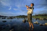 A popular recreational activity during a vacation or weekend in Main Brook, Newfoundland s fly fishing in Trout River.