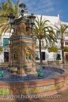 A beautiful ceramic tile fountain sits in the Plaza de Espana, in the village of Vejer de la Frontera along the Costa de la Luz in the Province of Cadiz in Andalusia, Spain.