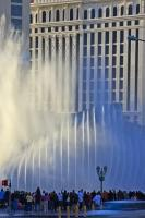 The orchestrated fountains of the Bellagio Hotel and Casino overshadows the architecture of Caesars Palace right next door in Las Vegas. By day the show looks somewhat different as the streams of water are highlighted by the shining sun.