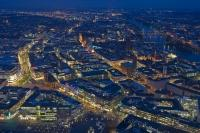 The night lights of Frankfurt lead off into the distance in this aerial picture of the city during dusk. The Main River wends its way through Frankfurt on its journey towards the Rhine River.