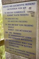 A sign relating to the history of Freising, Germany near Weihenstephan Brewery.