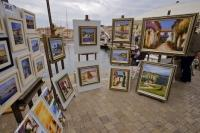 The waterfront of St Tropez is lined with stalls of art by local French artists of the Provence.