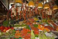 This colourful market stall at the Mercato Centrale in Florence, Italy sells all kinds of local produce, mainly fresh fruits and vegetables.