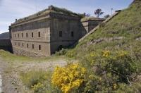 The ancient building of the Fuerte del Rapitan sits upon Fuerte del Rapitan Mountain in the city of Jaca in Huesca, Aragon in Spain.