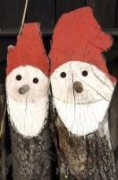 Two funny Santa Claus decorations made from stumps in the town of Morinka in the Czech Republic in Europe.