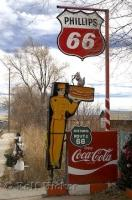 Some old road signs from the 50s look funny along Route 66 in Seligman, USA.
