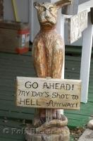 A carving of a cat with a funny sign along Route 66 in Seligman, Arizona.