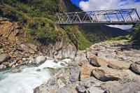 A bridge along State Highway 6 crosses the Gates of Haast, a series of rapids along the Haast River in Mt Aspiring National Park, West Coast, South Island, New Zealand.