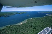 Flying in a waterplane over Georgian Bay on Lake Huron and the 30,000 Islands in Ontario, Canada, one will find the aerial view is spectacular on a sunny day.