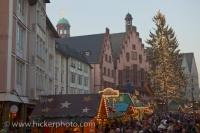 Crowds of people fill the Romerplatz outside the Romer or Town Hall in Frankfurt in Hessen, Germany while the Christmas Markets are open.