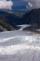 The 13 kilometre long Fox Glacier carves out a glacial path through the mountainous landscape of Westland National Park on the South Island of New Zealand.
