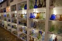Shelves of glass products line the factory at La Verrerie de Biot in the village of Biot in the Provence, France in Europe.
