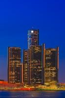 Also known as the Renaissance Center, the GM high rise office buildings are a cluster of skyscrapers situated on the international waterfront of the Detroit River - seen here at twilight.
