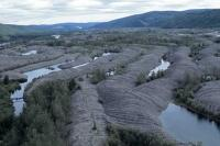 Gravel pits are the remnants of the gold claim of the late 19th century in Dawson City in the Yukon Territory.