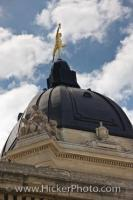 The top of the dome of the Manitoba Legislative Building in the City of Winnipeg is adorned with the Golden Boy statue.