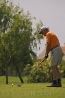 A man prepares to tee off with his driver at the Oliva Nova Golf Course in Valencia, Spain.