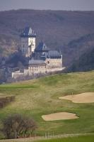 A popular vacation destination in the Czech Republic is the Karlstein Golf Course with stunning views of the Castle.