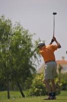 Watching the swing of this senior gentlemen as he plays at the Oliva Nova Golf Course in Valencia, Spain is a sure way to pick up some golfing tips.