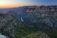 As the sun sets over the Alpes du Haute region of Provence in France, the sheer rock faces of the Gorges du Verdon turn pink.