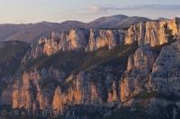 The rugged cliffs of the Gorges du Verdon in the Alpes de Haute in the Provence, France turn a beautiful shade of pink and yellow as the sun glistens off them at sunset.