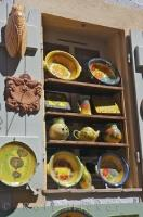 Unique french pottery adorns the outdoor shelves of store in the village of Gourdon, Alpes Maritimes, Provence, France.