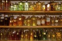Shelves full of bottles of different perfumes on display at La Source Parfumee in the village of Gourdon in Provence, France in Europe.